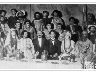 """ზაქარია ფალიაშვილის ოპერა """"აბესალომ და ეთერის"""" პრემიერის შემდეგ გადაღებული ჯგუფური სურათი. <br> ცენტრში, ოპერის მსახიობთა შორის, სხედან: ზაქარია ფალიაშვილი და ალექსანდრე წუწუნავა. <br> 1919 წელი, 21 თებერვალი. <br>  Group photo taken after the premiere of the opera """"Abesalom and Eteri"""" by Zakaria Phaliashvili. <br> Zakaria Phaliashvili and Alexandre Tsutsunava are sitting (in the center) among the opera artists. <br> 1919."""