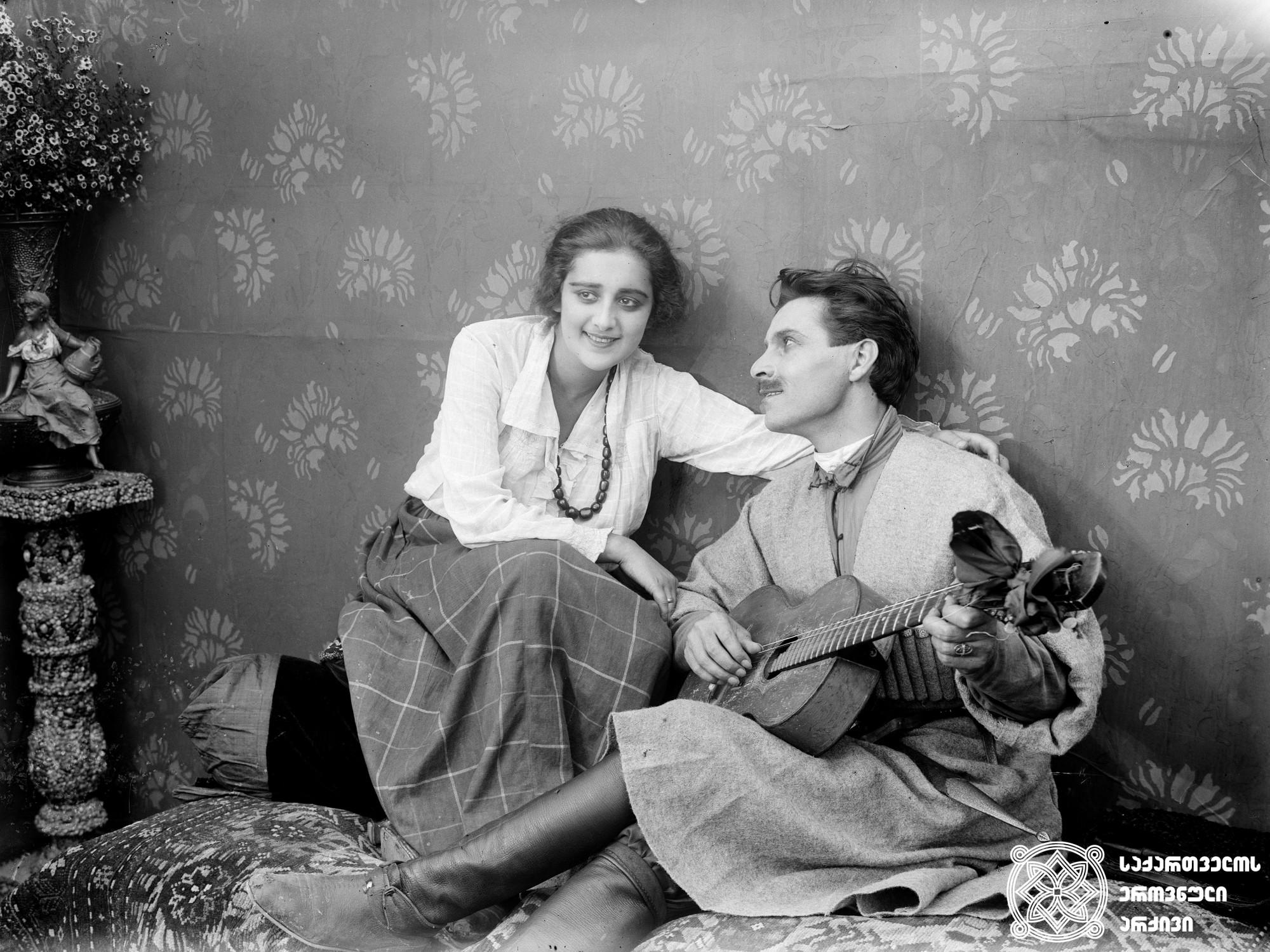 """""""სამი სიცოცხლე"""". 1924. <br>  სცენარის ავტორი და რეჟისორი: ივანე პერესტიანი. <br> ოპერატორი: ალექსანდრე დიღმელოვი.  მხატვარი: სემიონ გუბინ-გუნი. <br> ფილმი გადაღებულია გიორგი წერეთლის რომან """"პირველი ნაბიჯის"""" მიხედვით.  <br> ფოტოზე: ნატო ვაჩნაძე (ესმა) და მიხეილ გელოვანი (ბახვა ფულავა).   Sami Sitsotskhle (Three Lives). 1924. <br>  Screenwriter and director: Ivan Perestiani. <br> Camera operator: Alexander Dighmelov.  Production designer: Semion Gubin-gun.  <br> Filmed according to Giorgi Tsereteli's novel The First Step.<br> On the photo: Nato Vachnadze (Esma) and Mikheil Gelovani (Bakhva Pulava)."""