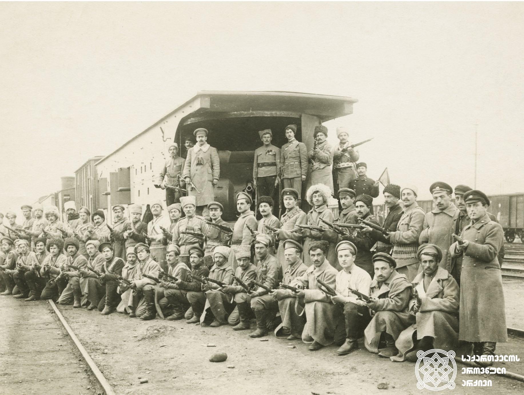 """ქართული არმიის ჯავშანმატარებელი <br> ჯავშანმატარებელთა რაზმში ირიცხებოდა ოთხი ჯავშანმატარებელი: """"რესპუბლიკელი"""", """"მუშა"""", """"სიკვდილი ან გამარჯვება"""" და """"თავისუფლების სიმაგრე"""". <br>  Armored train of the Georgian Army. <br> Following four armored trains were counted in the division of the armored trains: <br>""""Respublikeli"""" (Republican), """"Musha"""" (Worker), """"Sikvdili an Gamarjveba"""" (Death or Victory) and """"Tavisuflebis Simagre"""" (Independence Fortress)."""